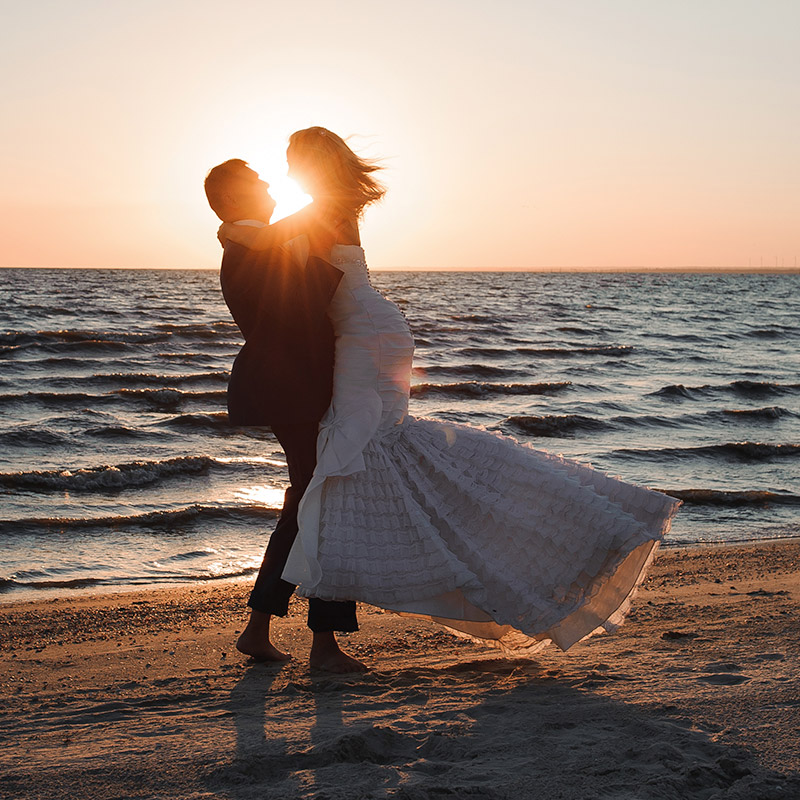 Wedding couple on beach in sunset