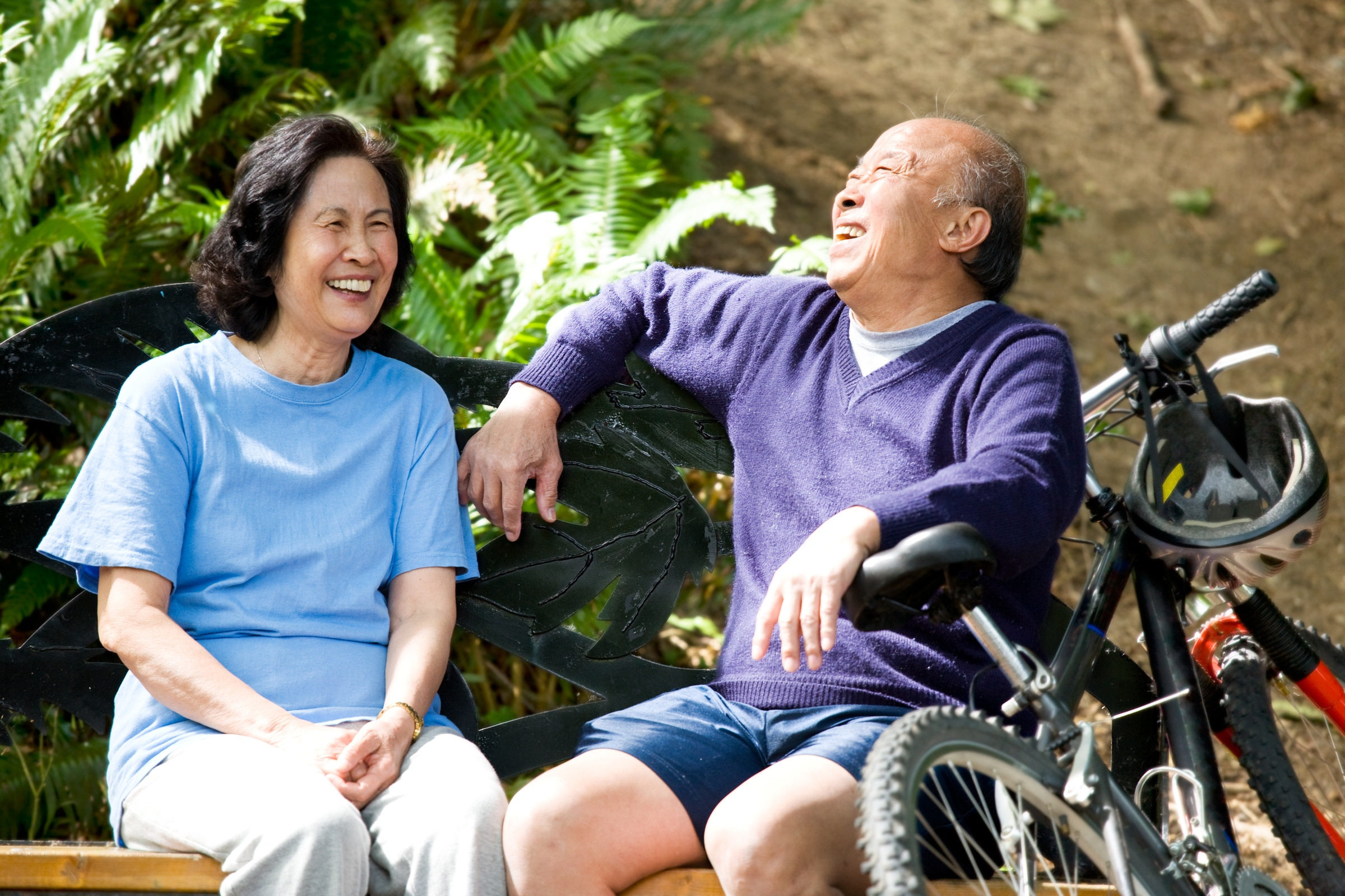 Older couple laughing and talking outside
