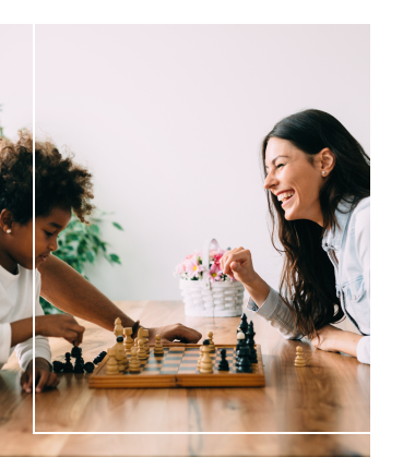 Family-playing-chess-on-table