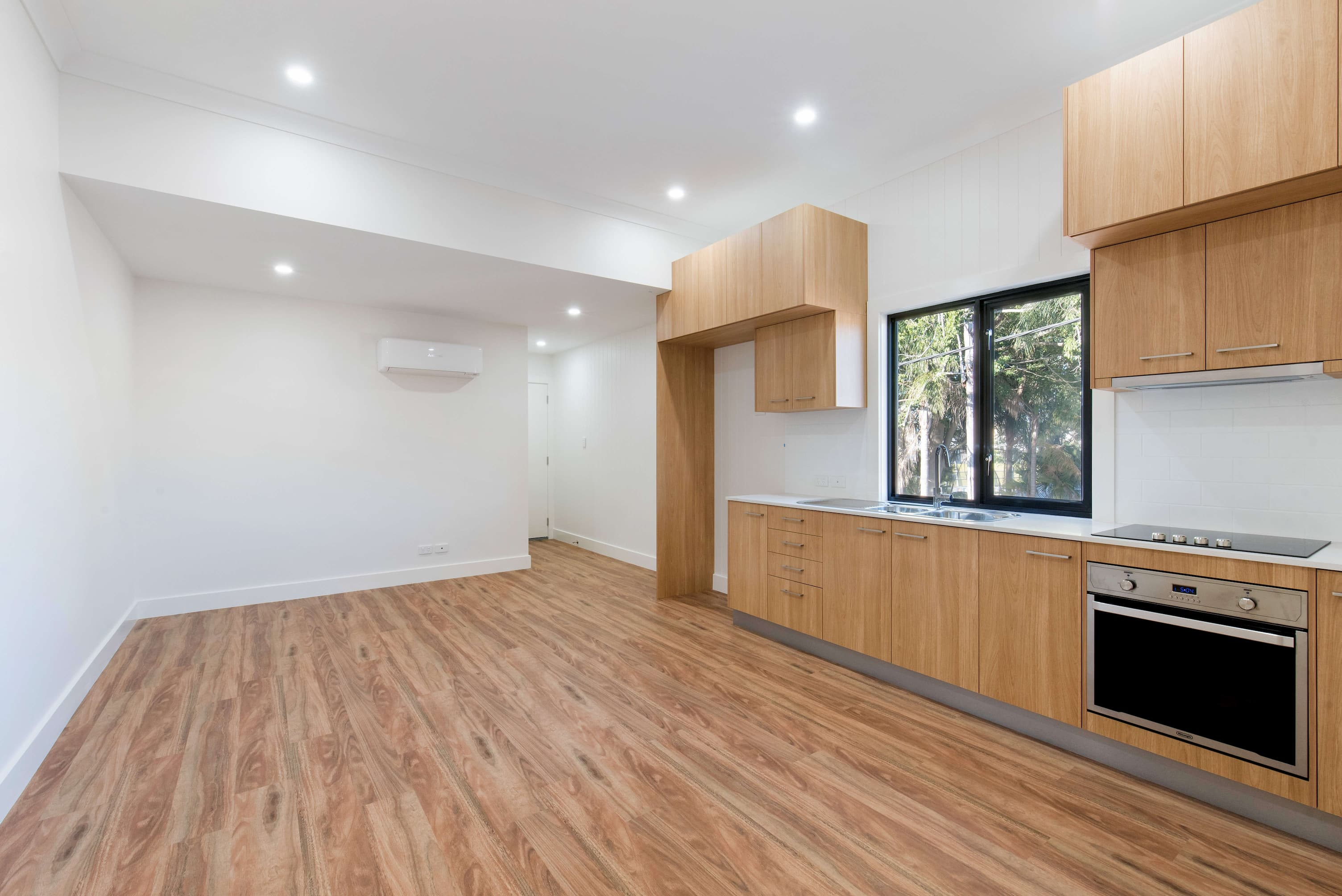 Newly renovated home kitchen with wood floors