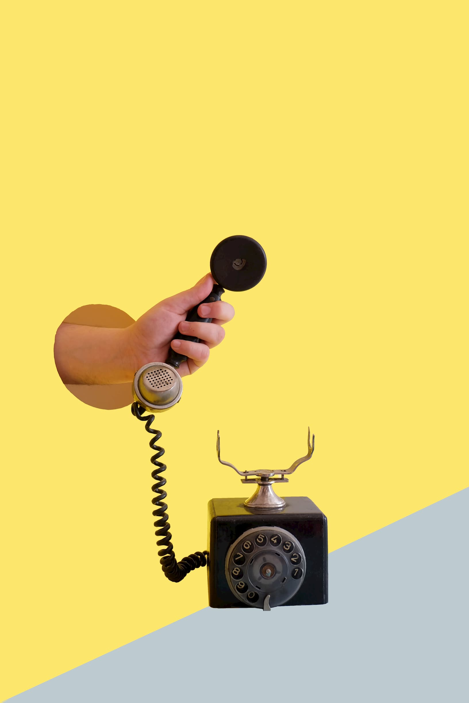 Old style corded phone on white background