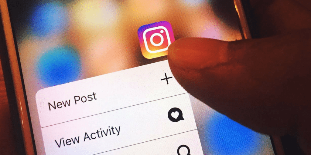 Person adding new post on instagram