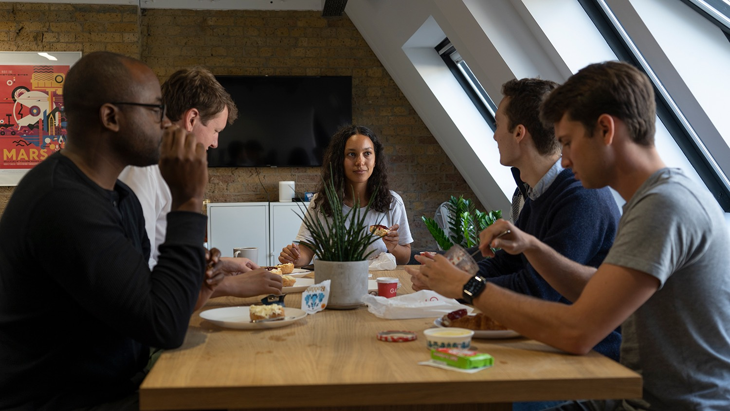 The team sitting at the table and eating