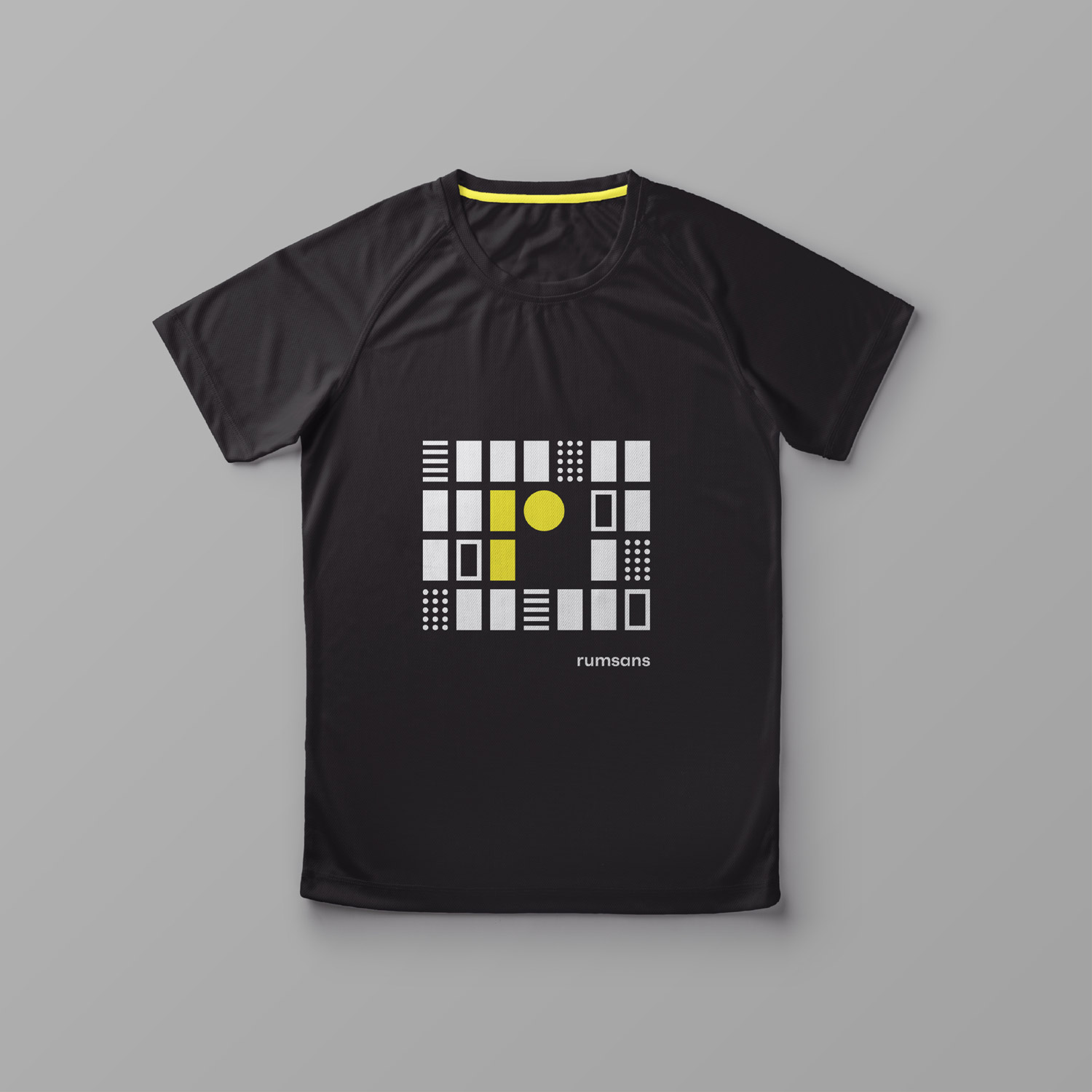 Mobile phone displaying the Rumsans instagram on the screen. Black t-shirt printed with the Rumsans visual identity consisting of graphic elements in the colors black, white and yellow.