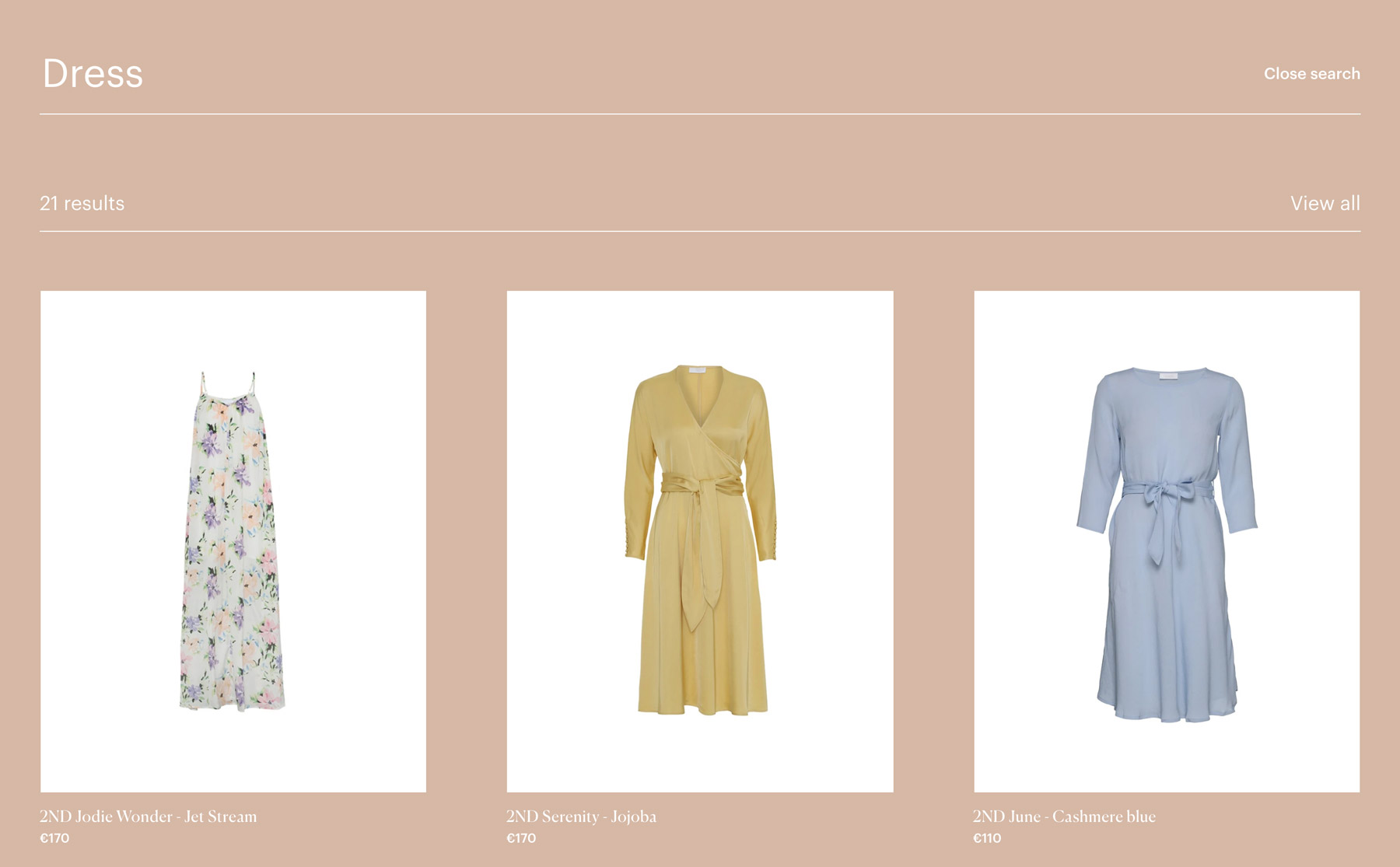 Three dresses in a preview display when using the search function in the 2NDDAY webshop. You can choose one or see all.