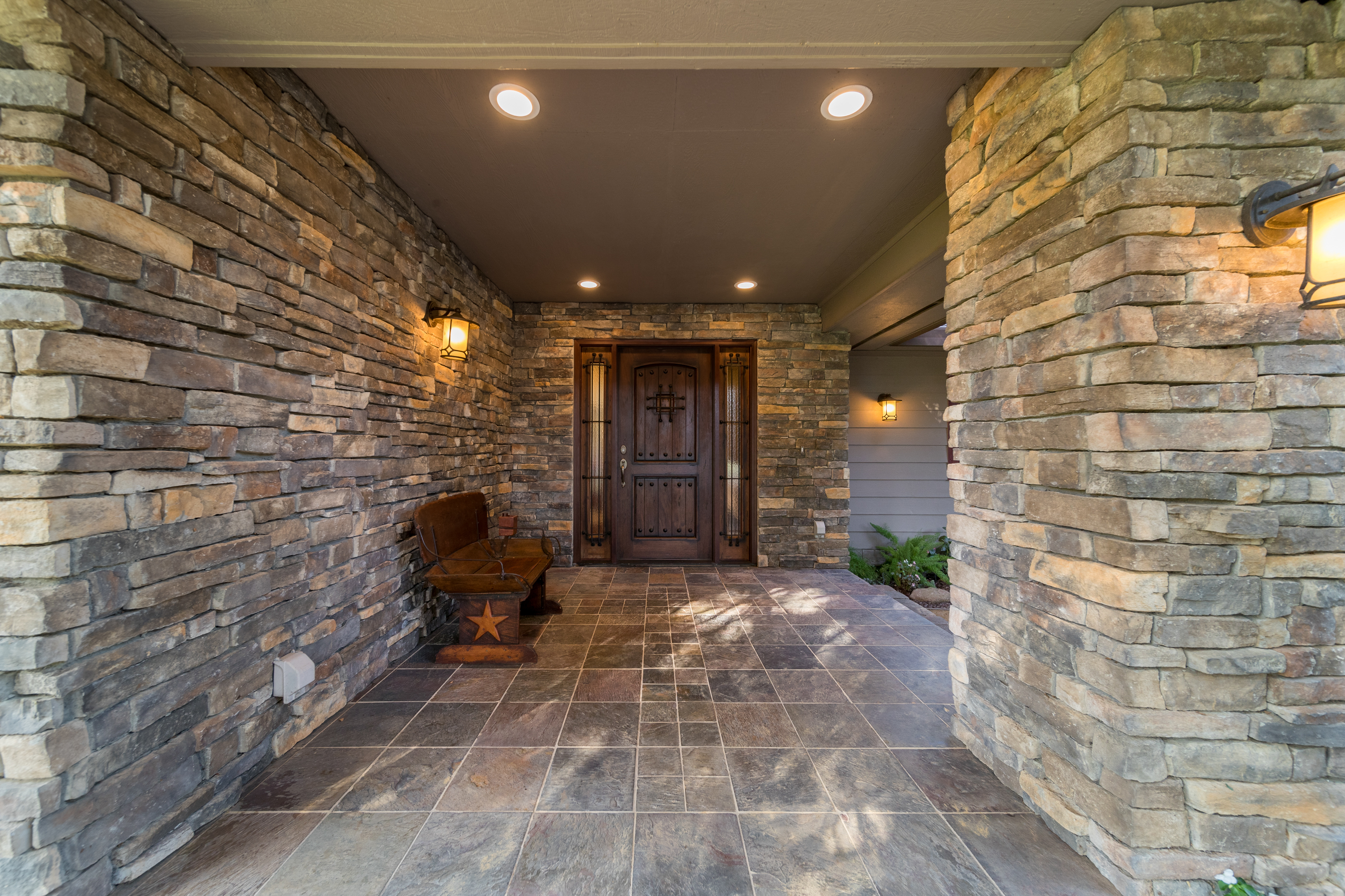 photography portfolio example - front porch with wooden front door and cobblestone exterior