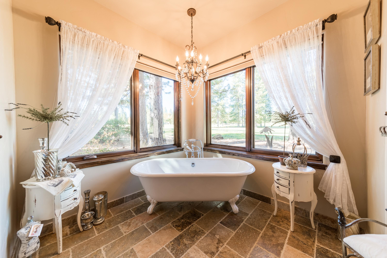 photography portfolio example - luxury master bathroom with claw tub and surrounding windows