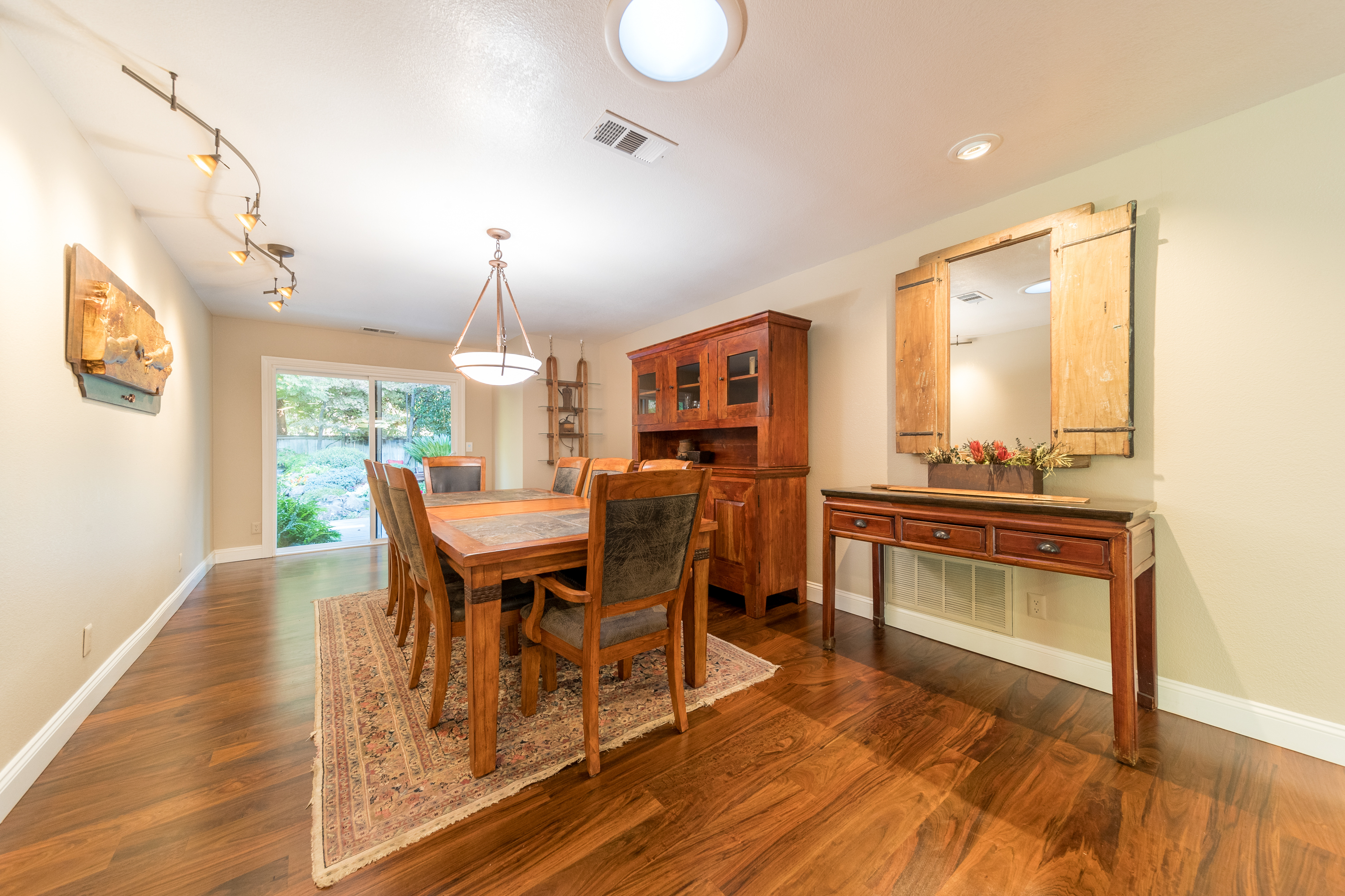 photography portfolio example - home dining room with wooden floors and dutch doors leading outside