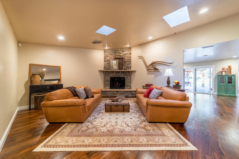 photography portfolio example - warm family room with cobblestone fireplace and hardwood floors