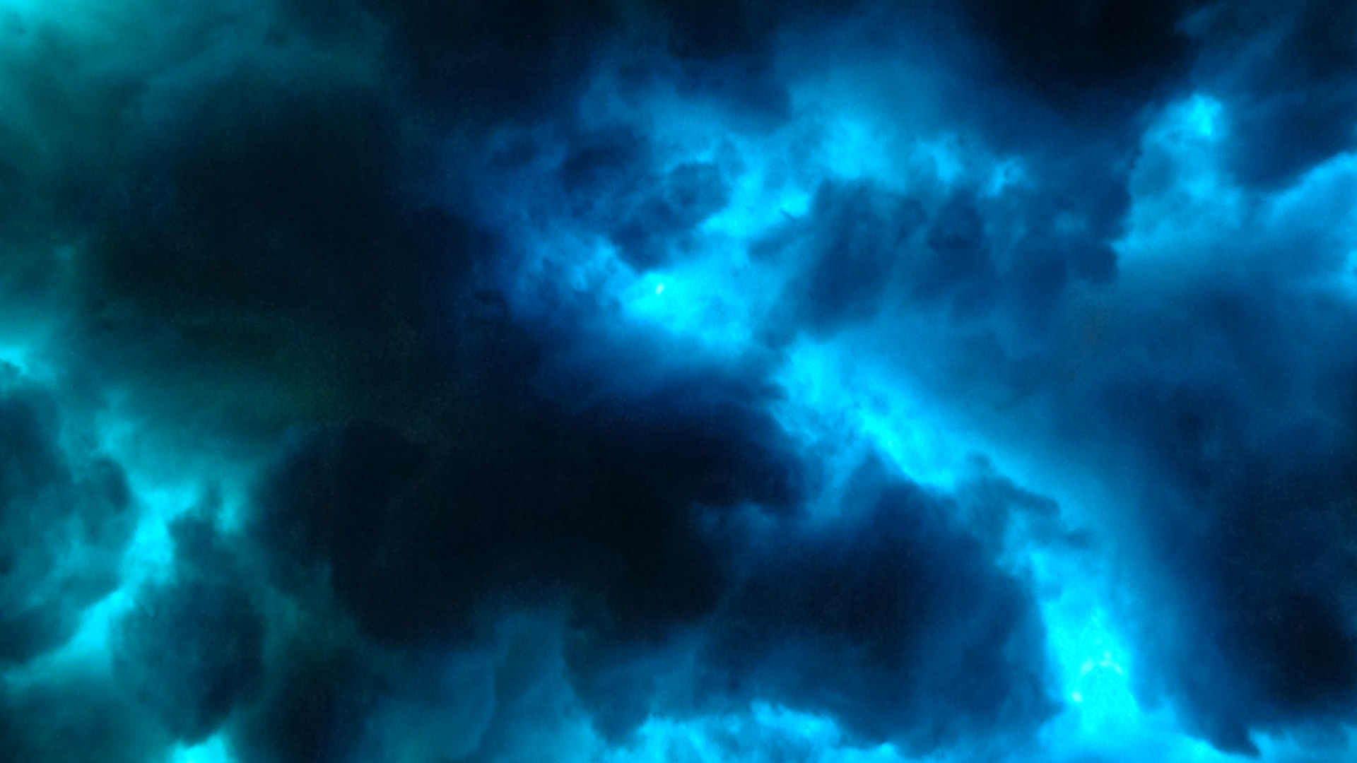 An art installation that looks like blue and black, ominous clouds