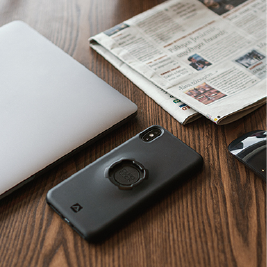 Phone, laptop and newspaper on a desk