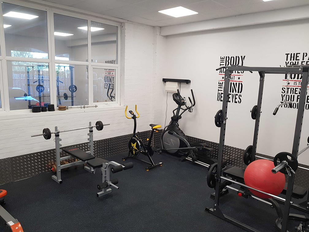 A photo of Metricell's gym showing weights, a bike and other exercise equipment