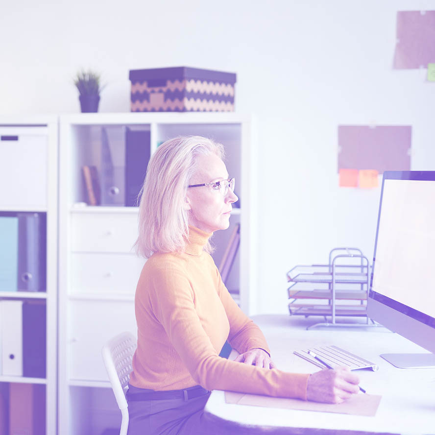 Photo of a woman working at a desk