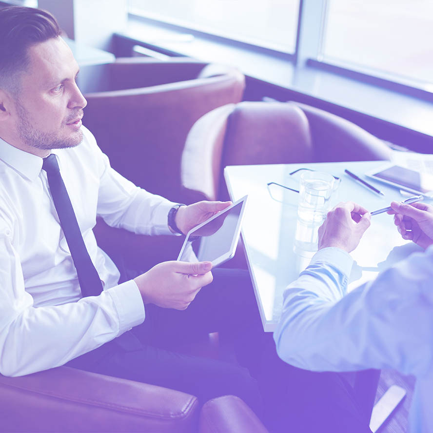 Photo of two business people in a meeting