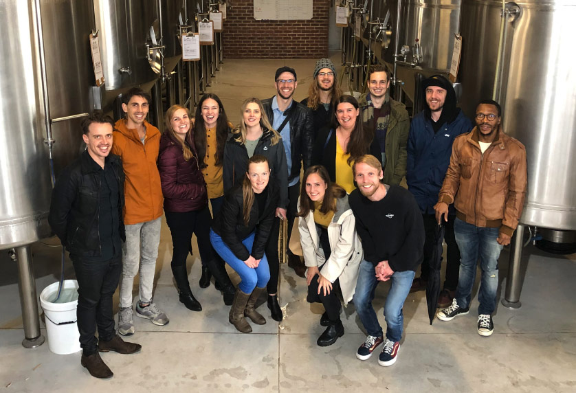 A team group photo on an outing to local brewery Woodstock Brewery.