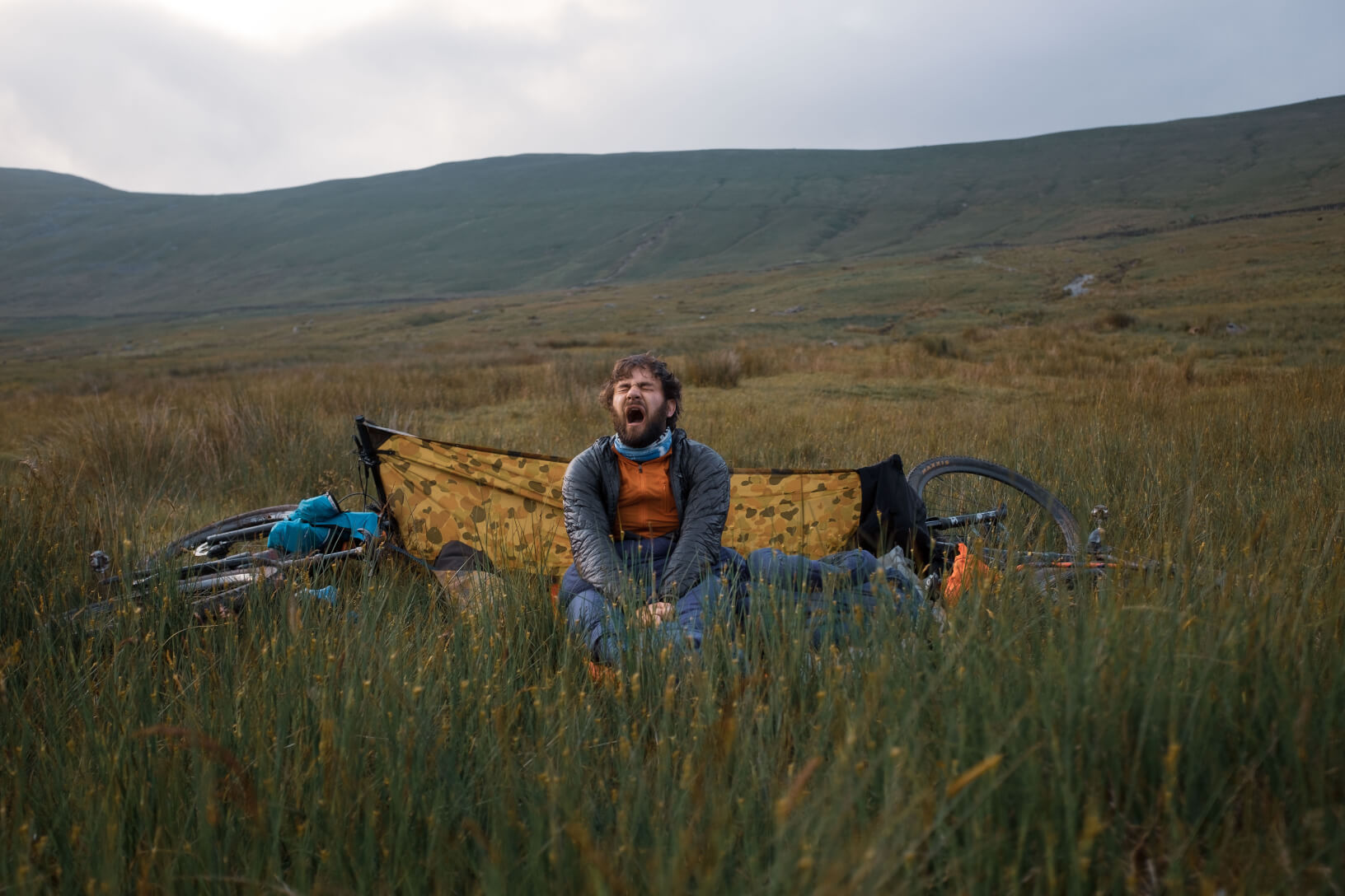 Christian Smith of Outdoor Provisions bikepacking in remote countryside