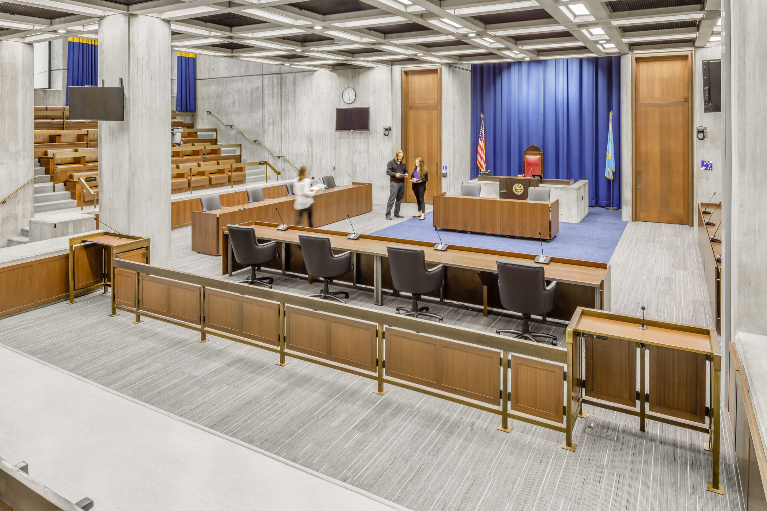 Interior view of Boston City Hall Council Chambers, showing the poured-in-place concrete walls and concrete ceiling beams, typical of Brutalist architecture