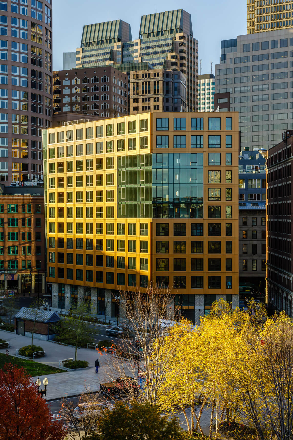 The Boulevard glowing yellow-orange in fall light, from across the Rose Kennedy Greenway.