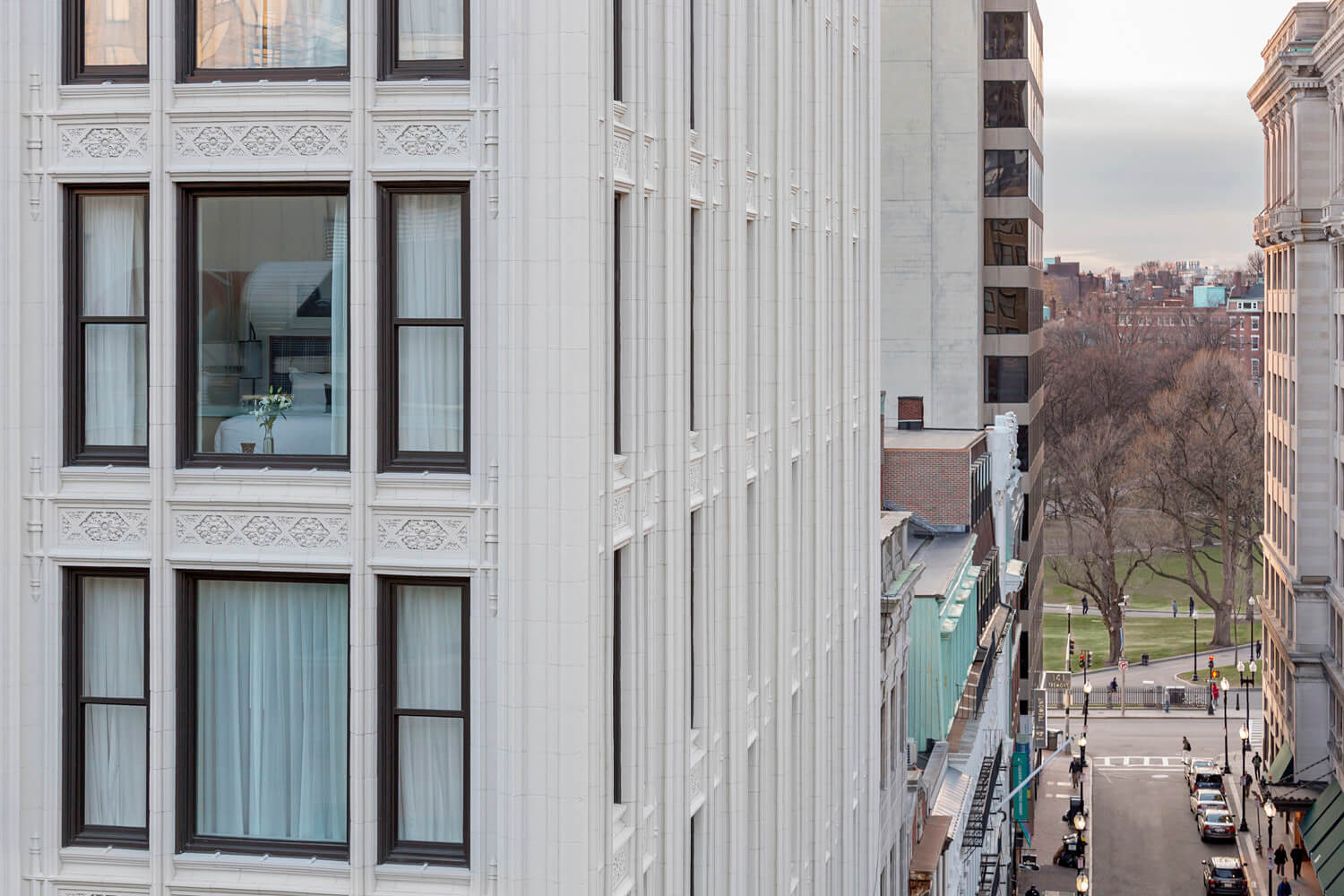 Detailed view of the Blake building facade, with views into two of the hotel rooms.