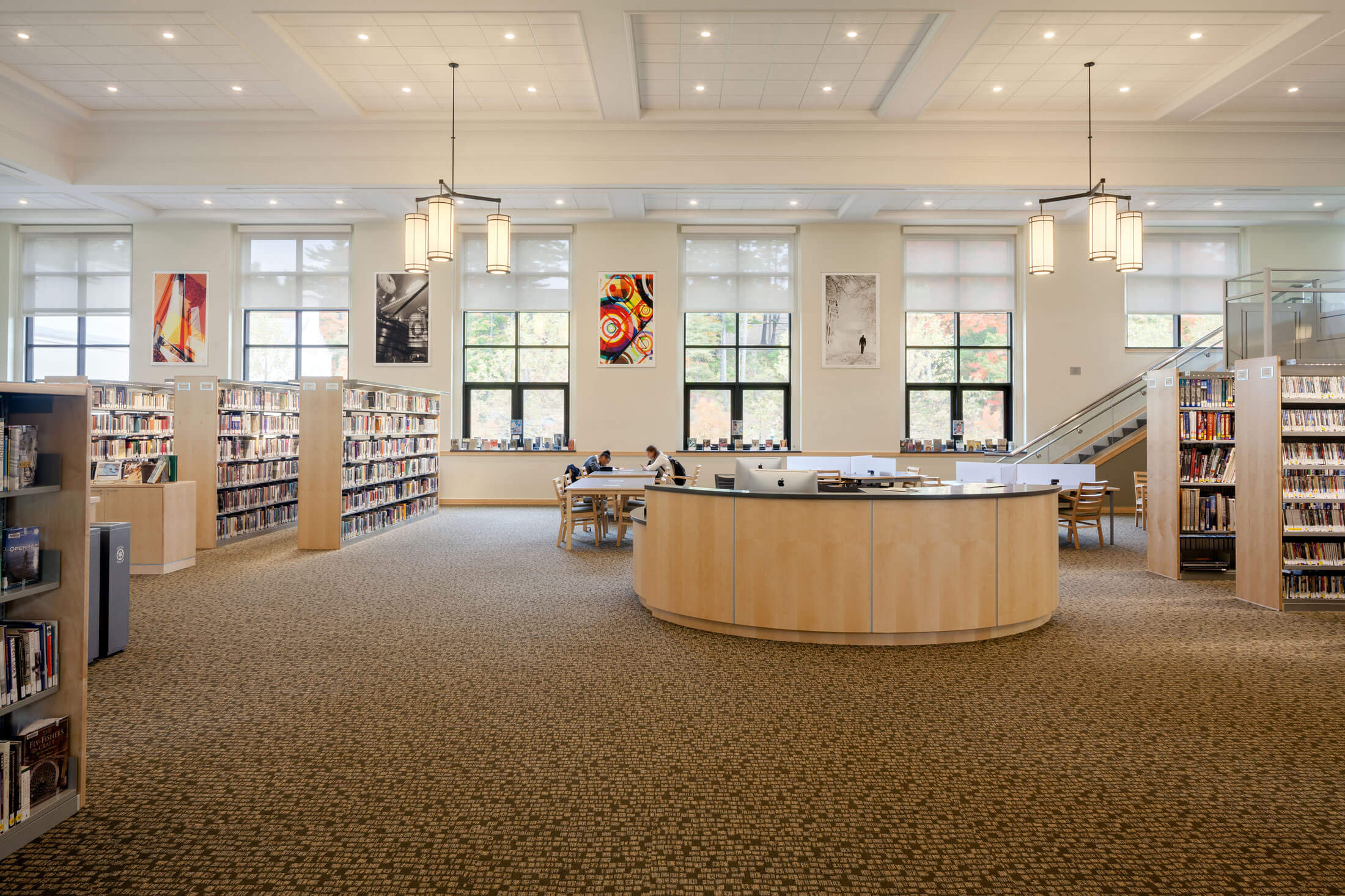 Interior view of Geier Library at Berkshire school, showing the high ceilings that speak to the building's former use as a gymnasium