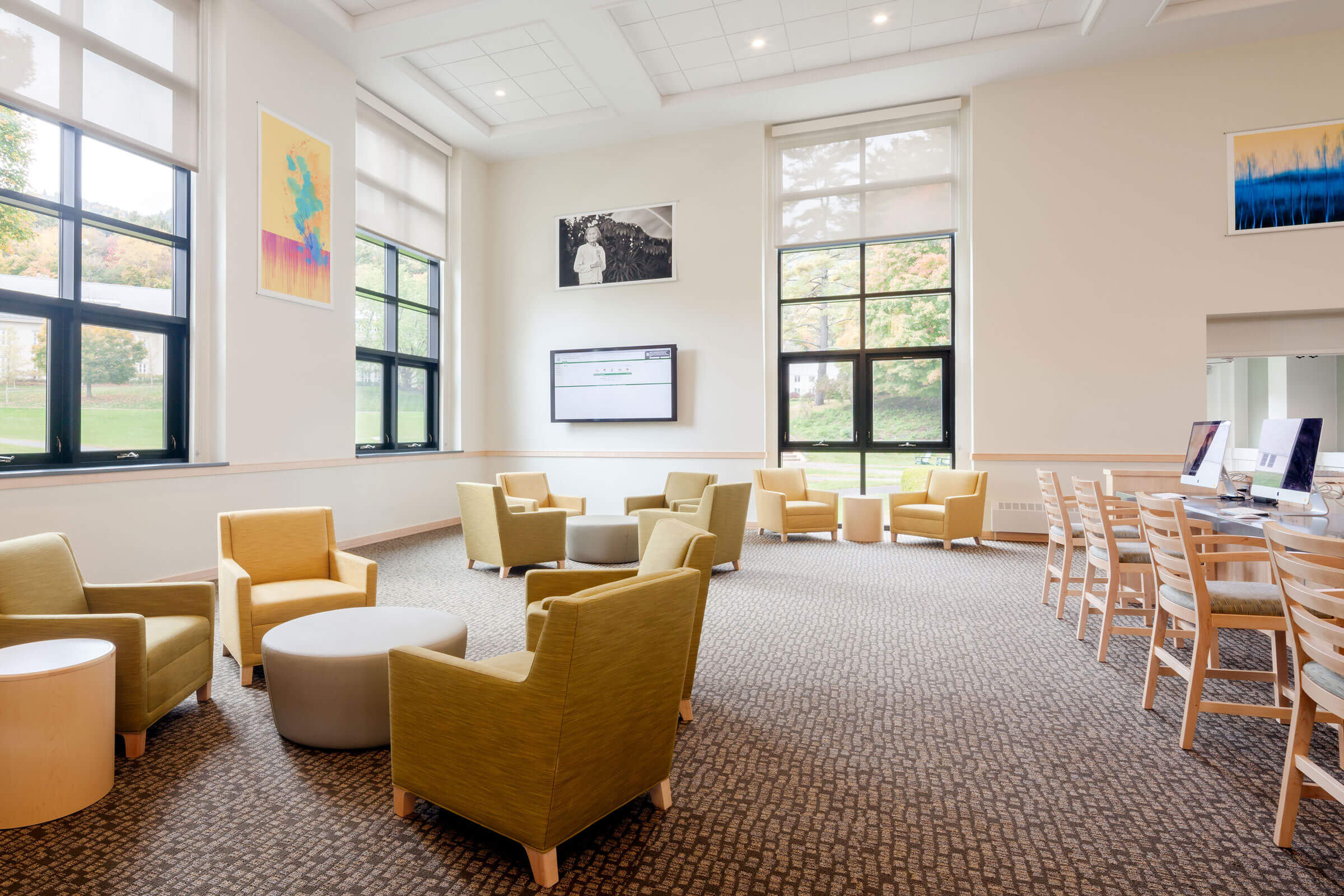 Interior view of Geier Library at Berkshire School, showing soft seating and also new windows installed during the building's renovation