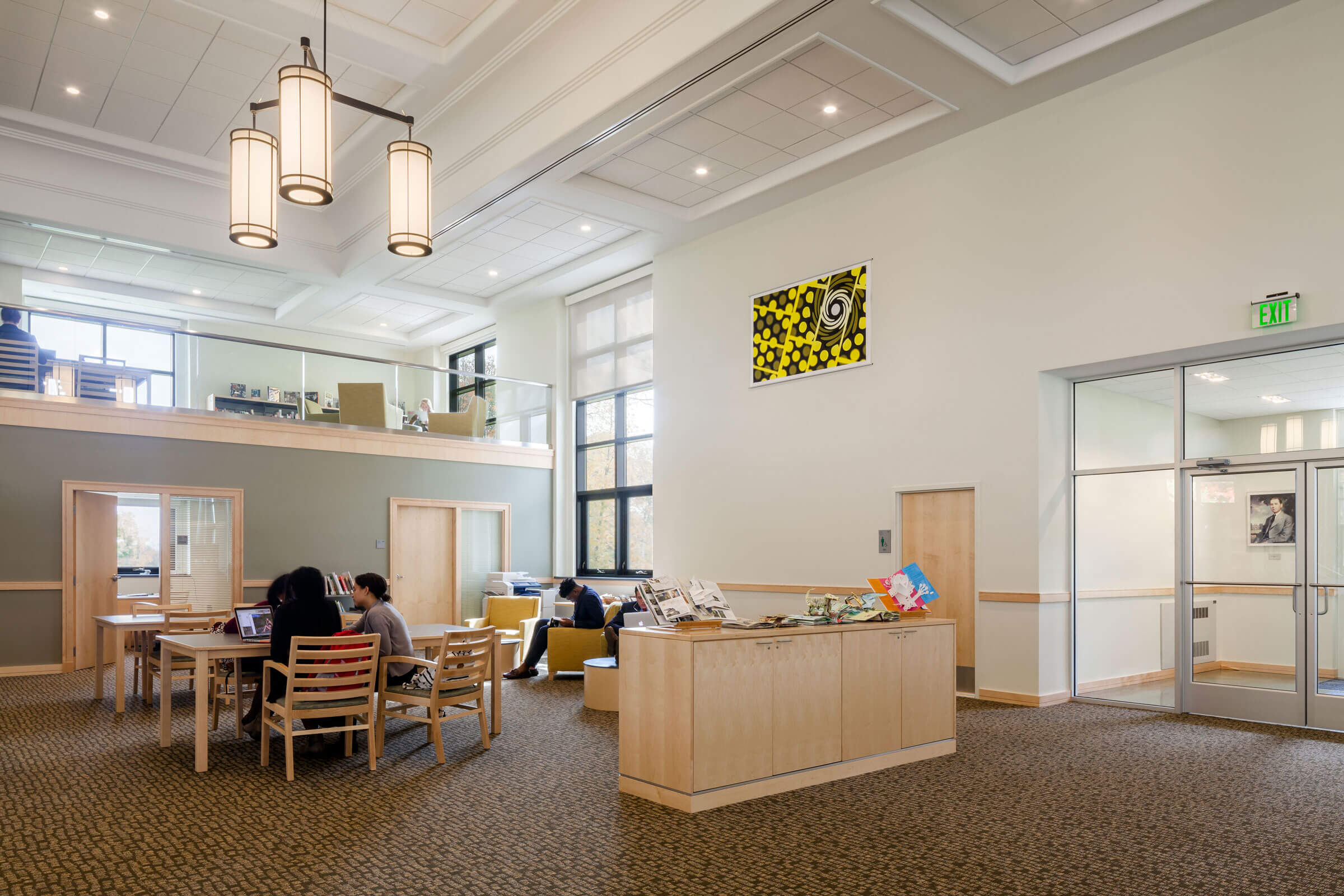 Finegold Alexander's renovation of Geier Library at Berkshire School allows for the display of student artwork in a clean, contemporary setting, as shown in this interior view of the library