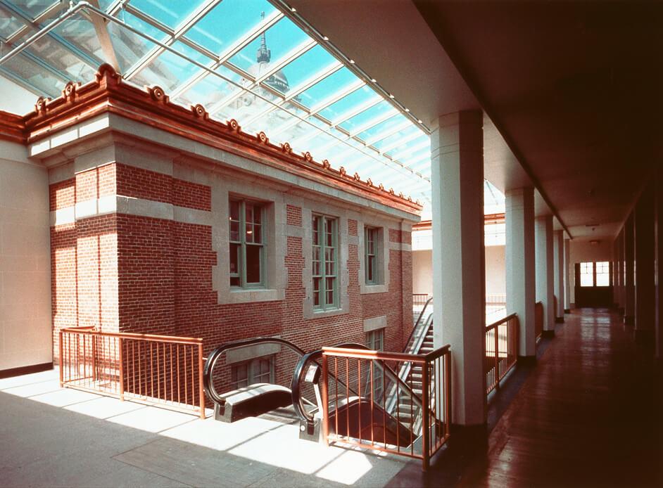 Escalators underneath a glass skylight at the Ellis Island Museum of Immigration.