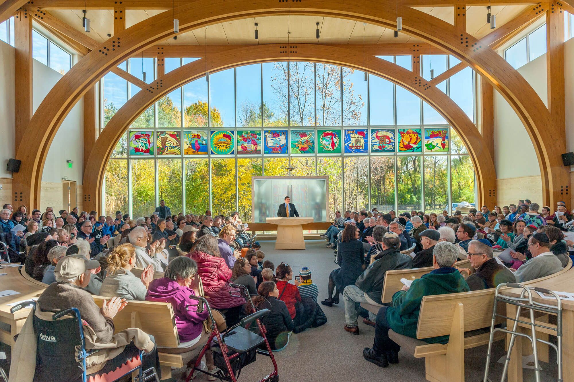 The congregation gathered on a bright spring day under the wooden arches in the sanctuary.