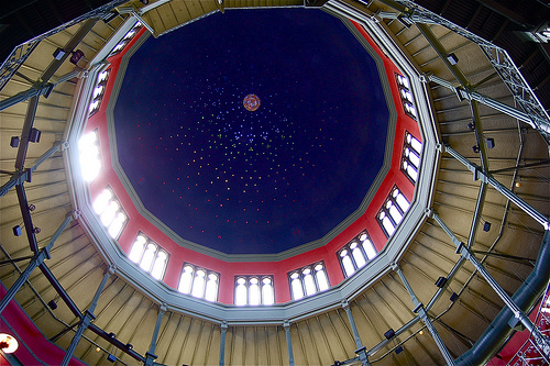 Interior view of Nott Memorial's dome structure, characterized by metal detailing, and red and blue colors, from below.