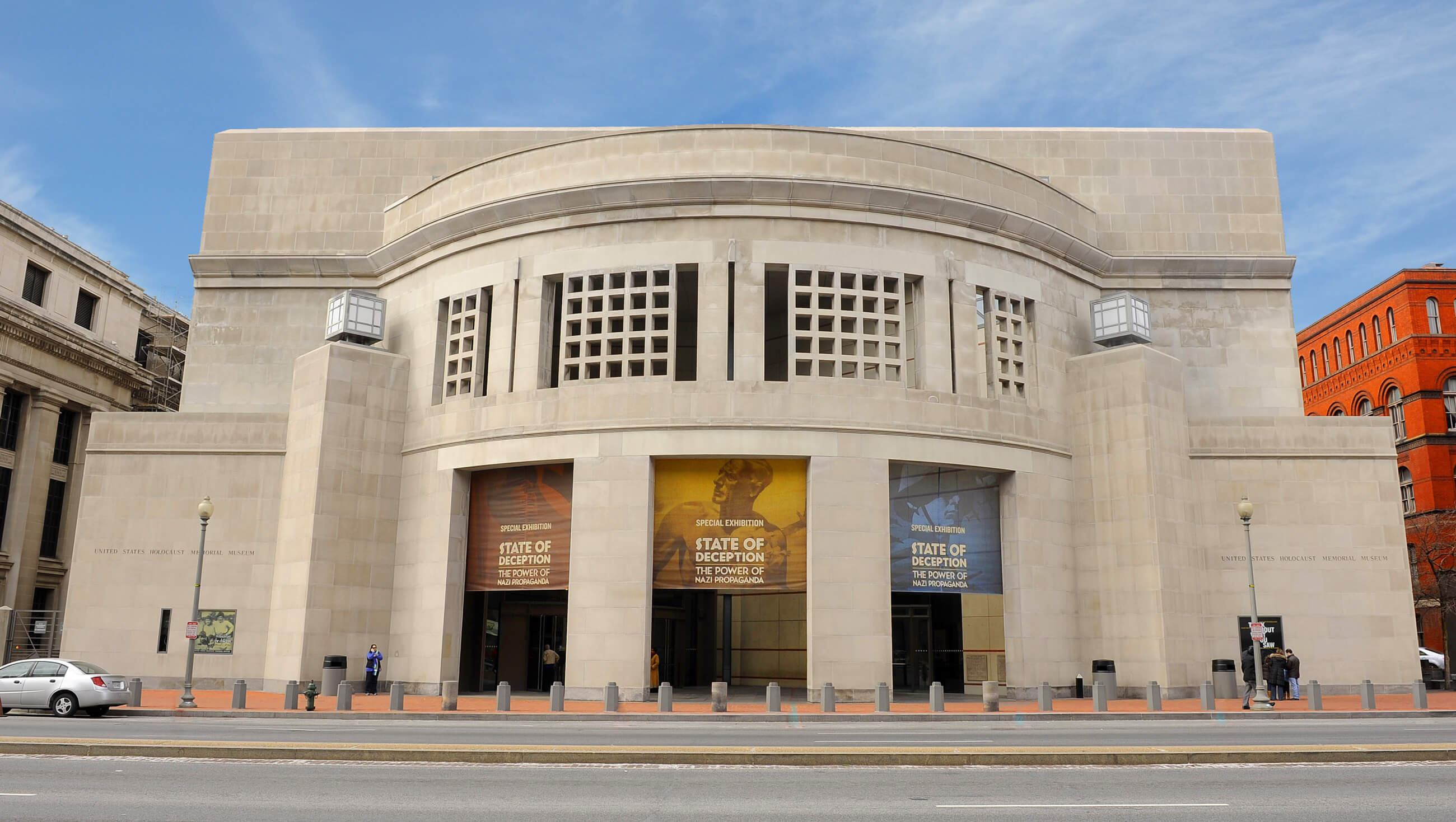 Front view of the United States Holocaust Memorial Museum, characterized by an imposing and monumental, geometric stone presence.