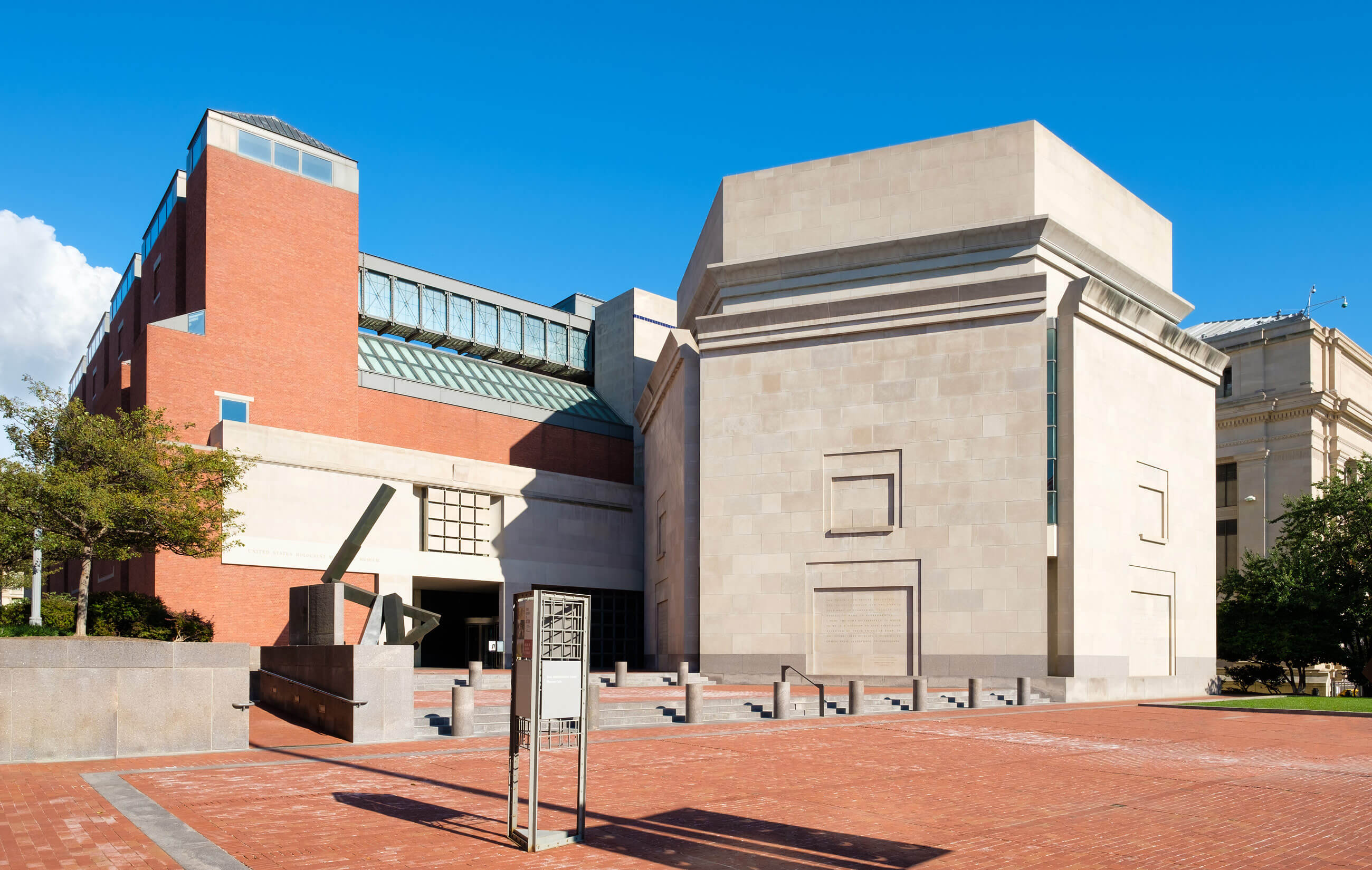 Hexagonal stone extension of the United States Holocaust Memorial Museum on a brick plaza.