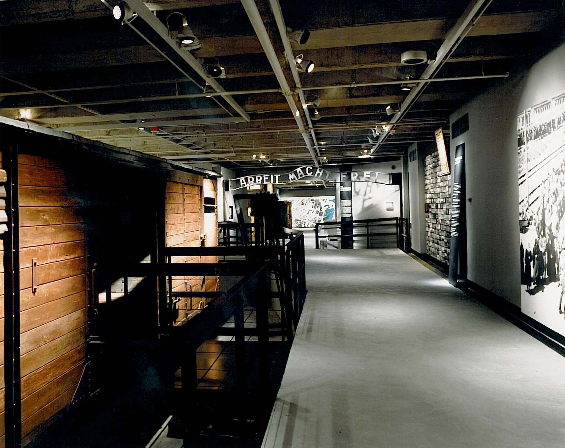Dark elevated walkway in the permanent exhibition of the United States Holocaust Memorial Museum.