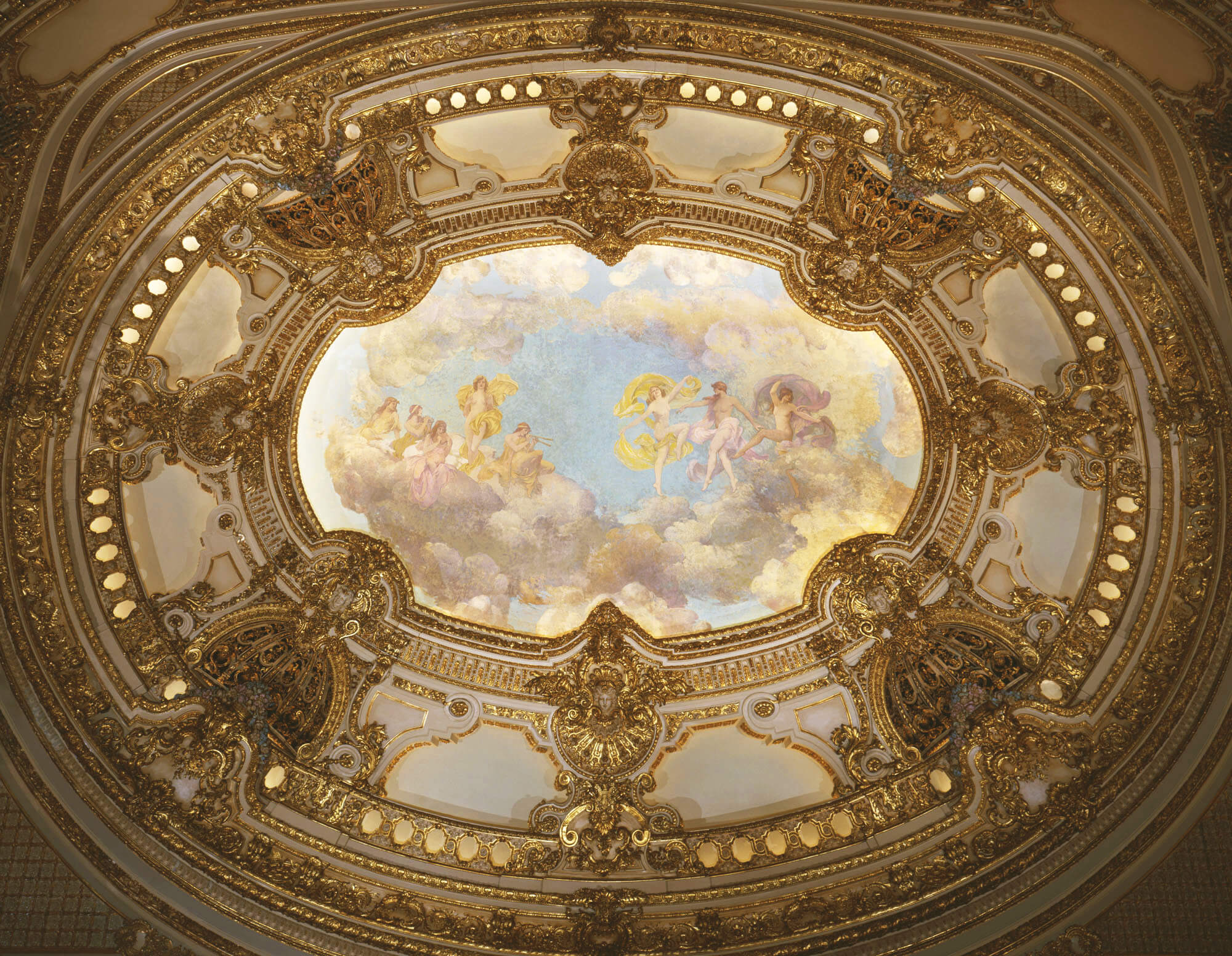 Ornate ceiling painting with dancing angels on clouds.