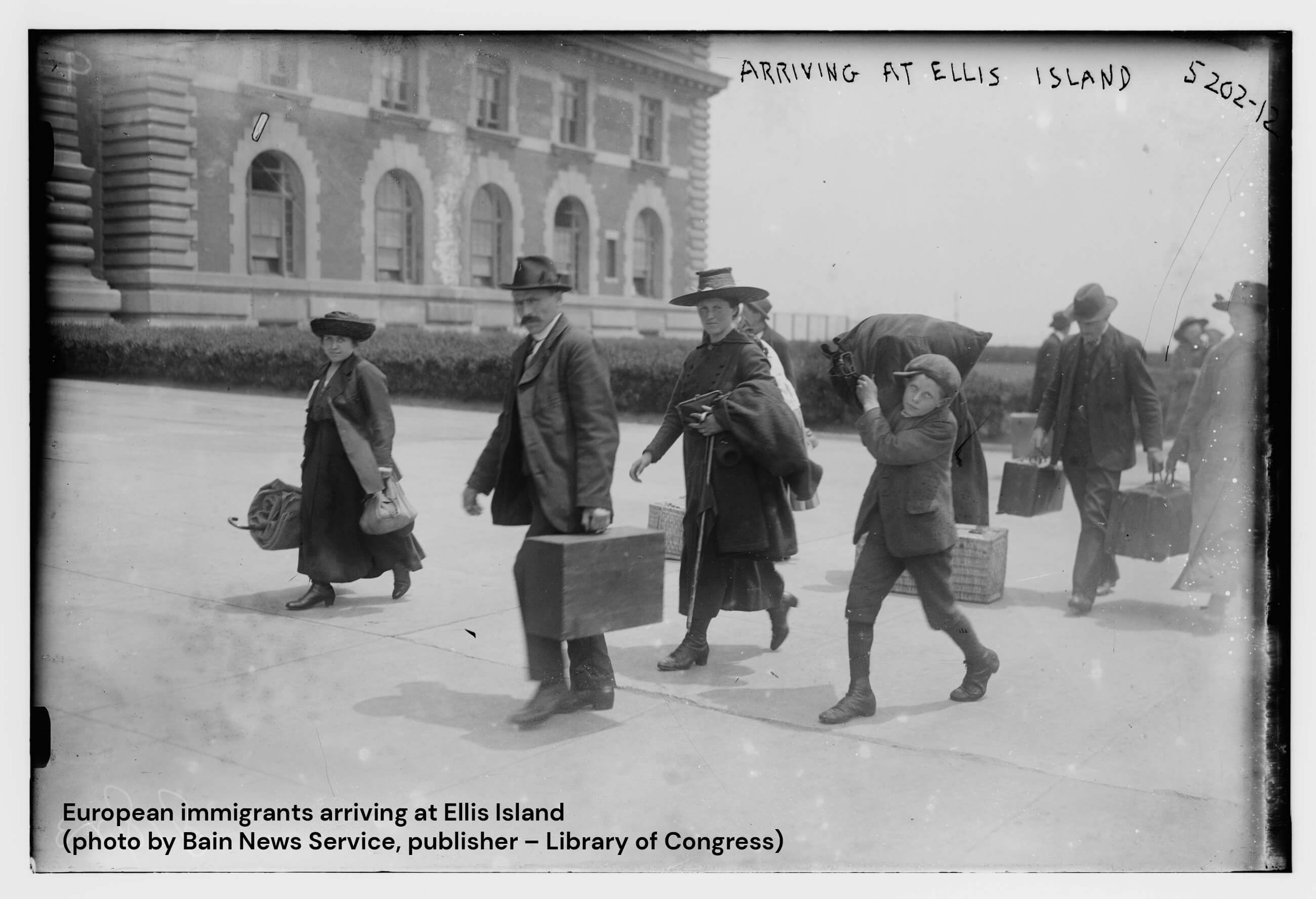 European immigrants arriving at Ellis Island with suitcases.