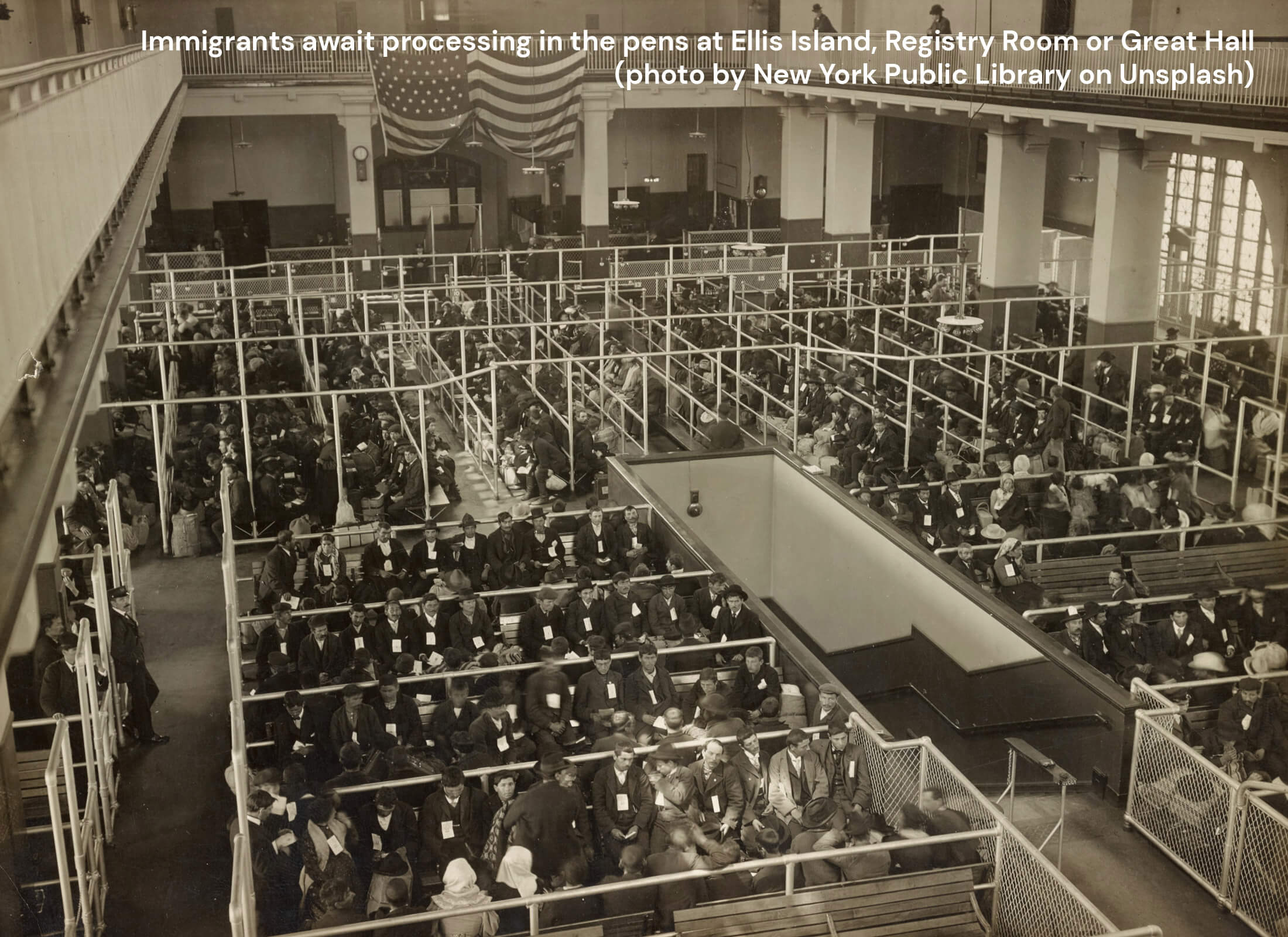 Immigrants awaiting processing in the pens at Ellis Island Registry Room or Great Hall.