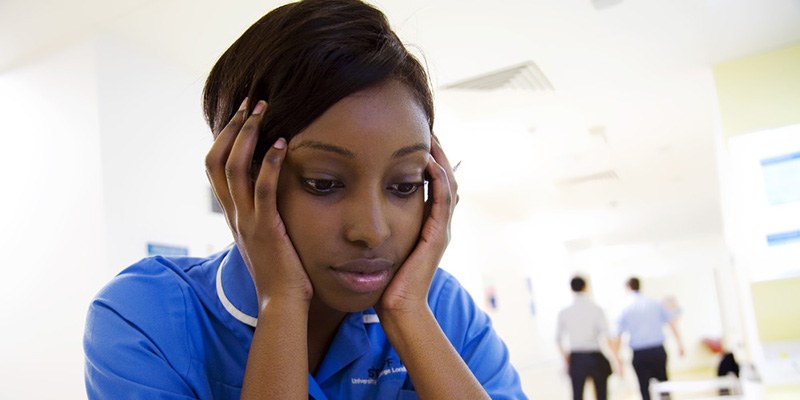 stressed uk nurse