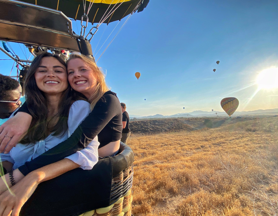 Two women in a hot air balloon.
