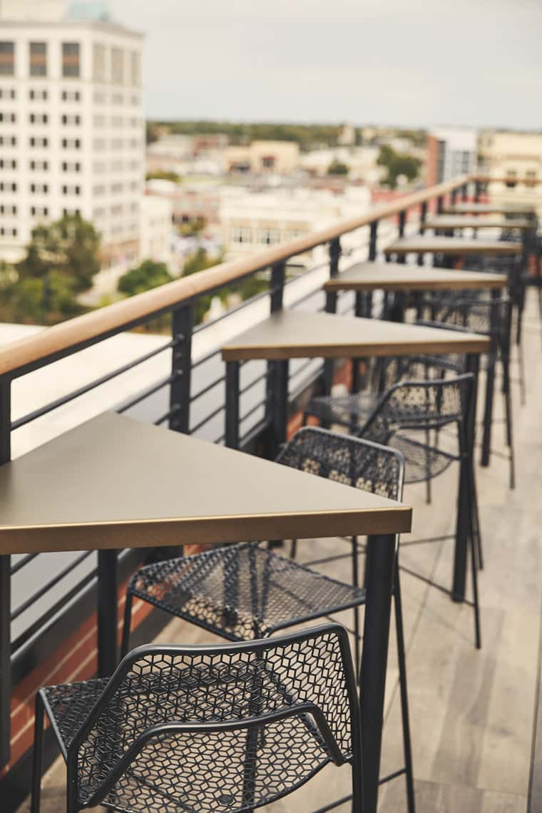 triangle tables on Vantage outdoor rooftop lounge area