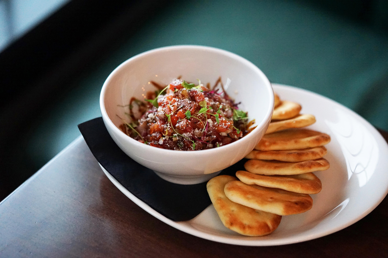 Bowl of ahi tuna with pita bread