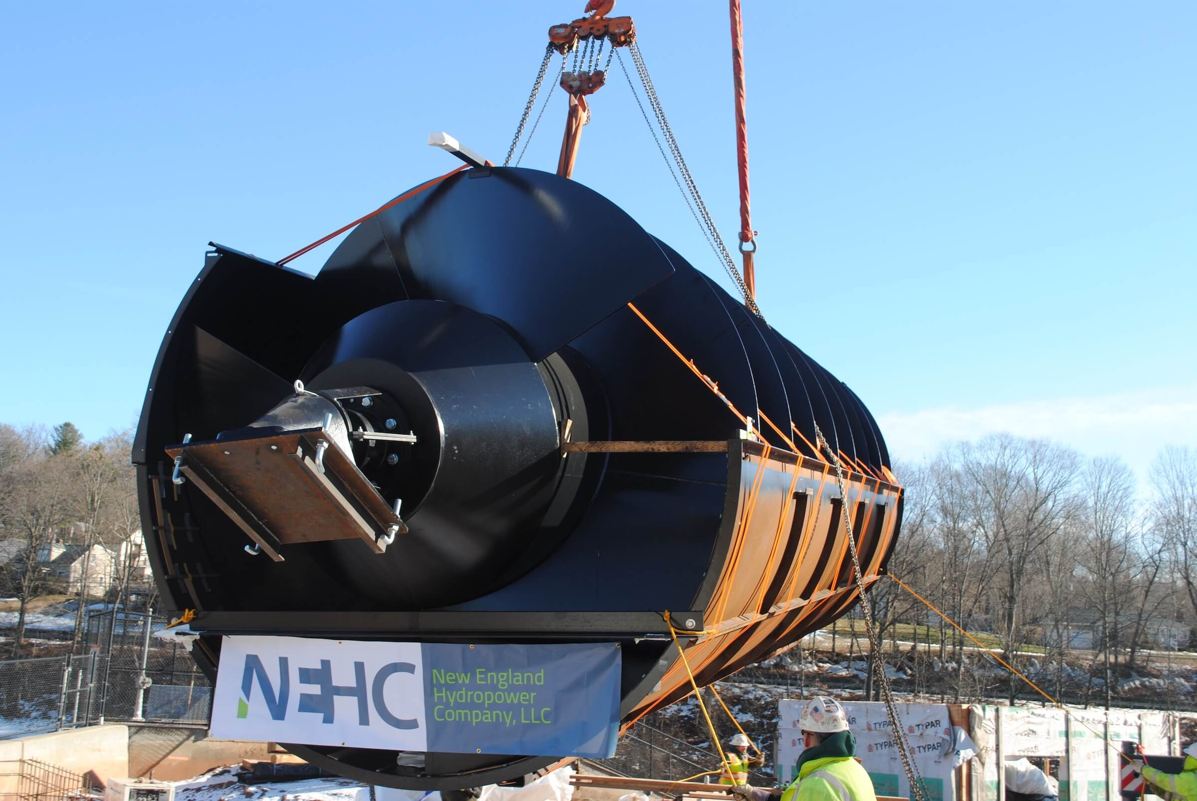 Lifting Archimedes Screw Turbine into place with NEHC signage