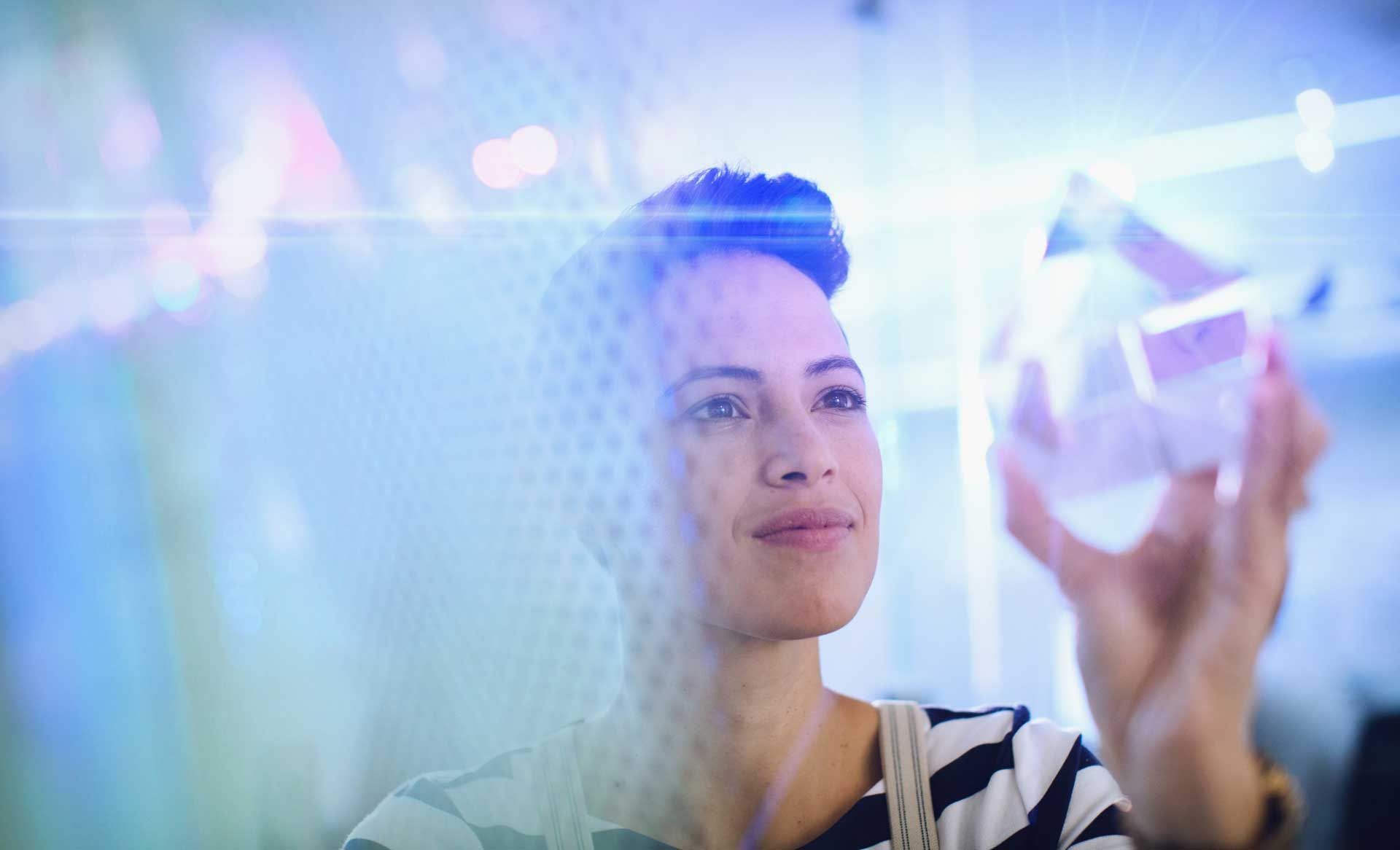 A woman inspecting a glass prism