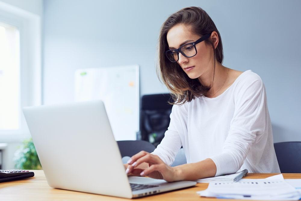 Focused Businesswoman Working on Pinterest