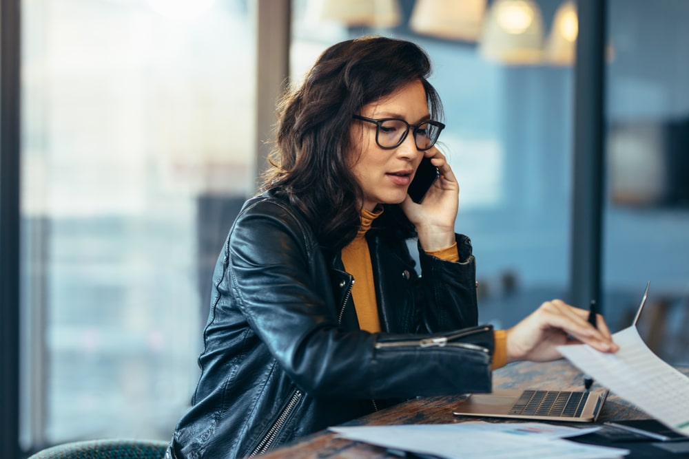 Asian Businesswoman Working at Desk Focused