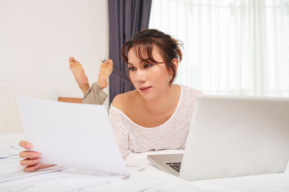 Transgender Woman Working Productively at Home