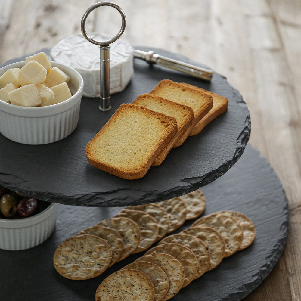 Slate cheeseboard service platter on dining table