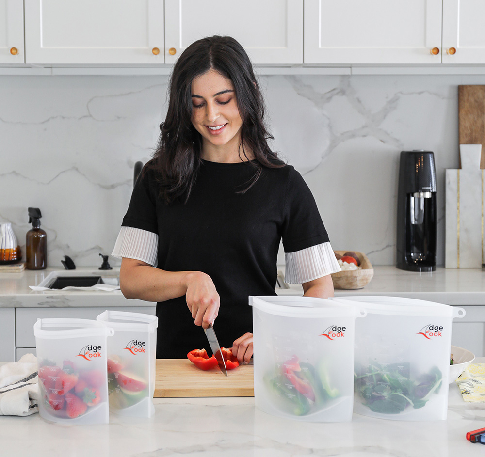 Woman cooking in the kitchen using reusable silicone food storage bags