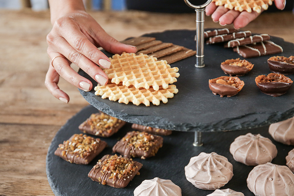 Cookie and chocolate assortment on slate serving tray