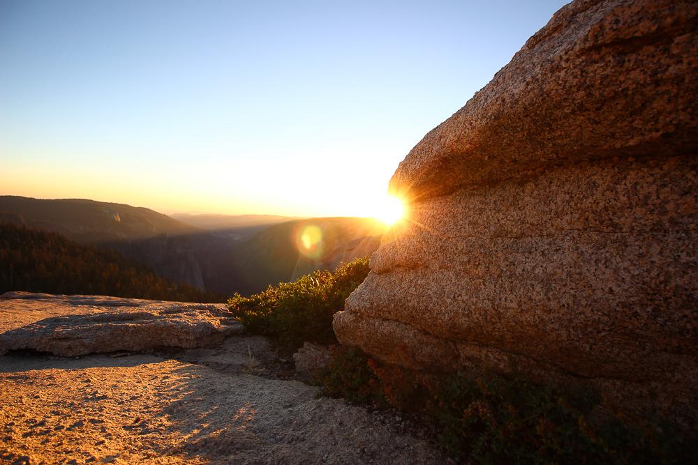 Sunset hiding behind big rock Yosemite National Park