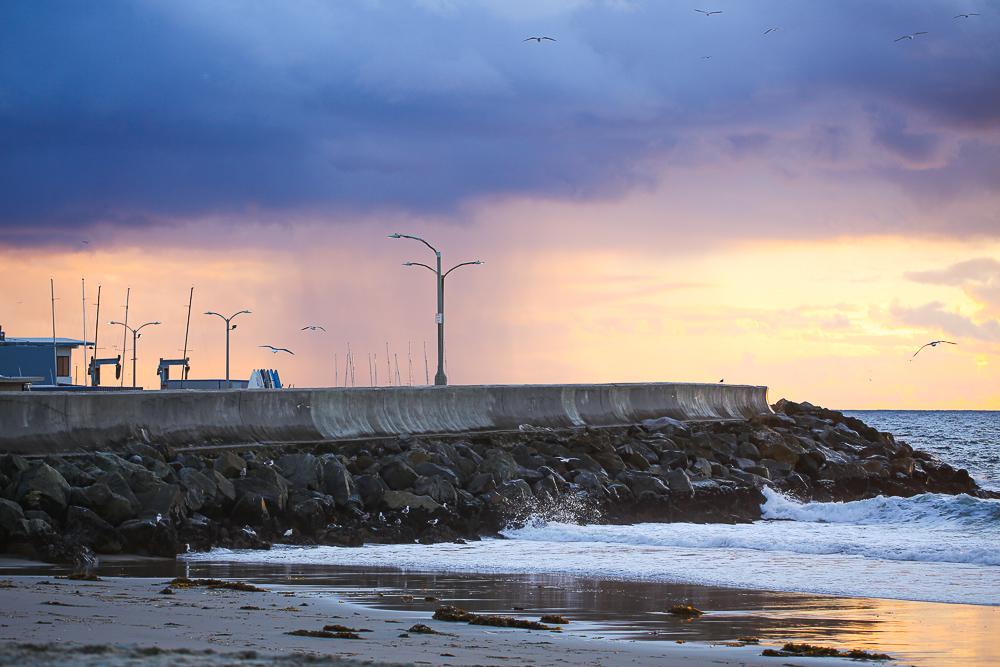 Ocean pier sunset windy ocean waves