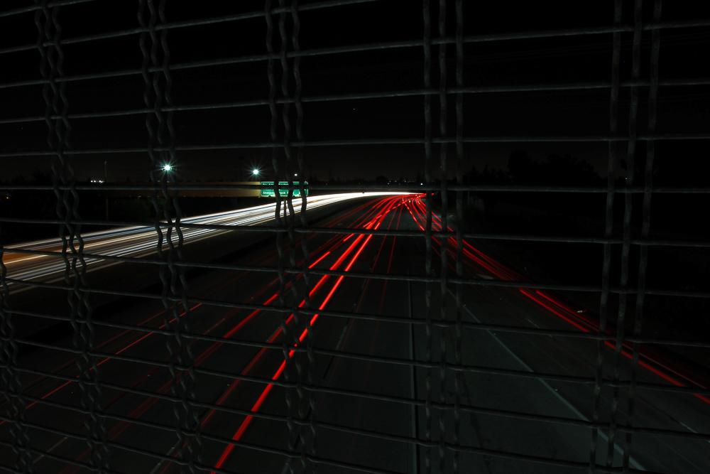 Streaking car lights driving on freeway long exposure